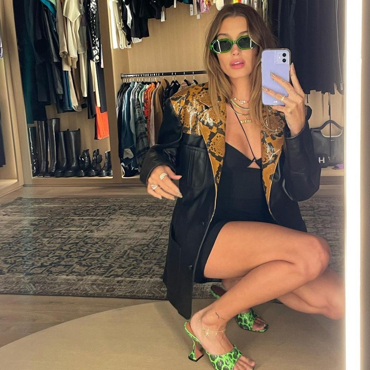 Hailey Bieber taking Instagram mirror selfie with green sunglasses