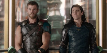 Thor and Loki stand side by side in Thor: Ragnarok.