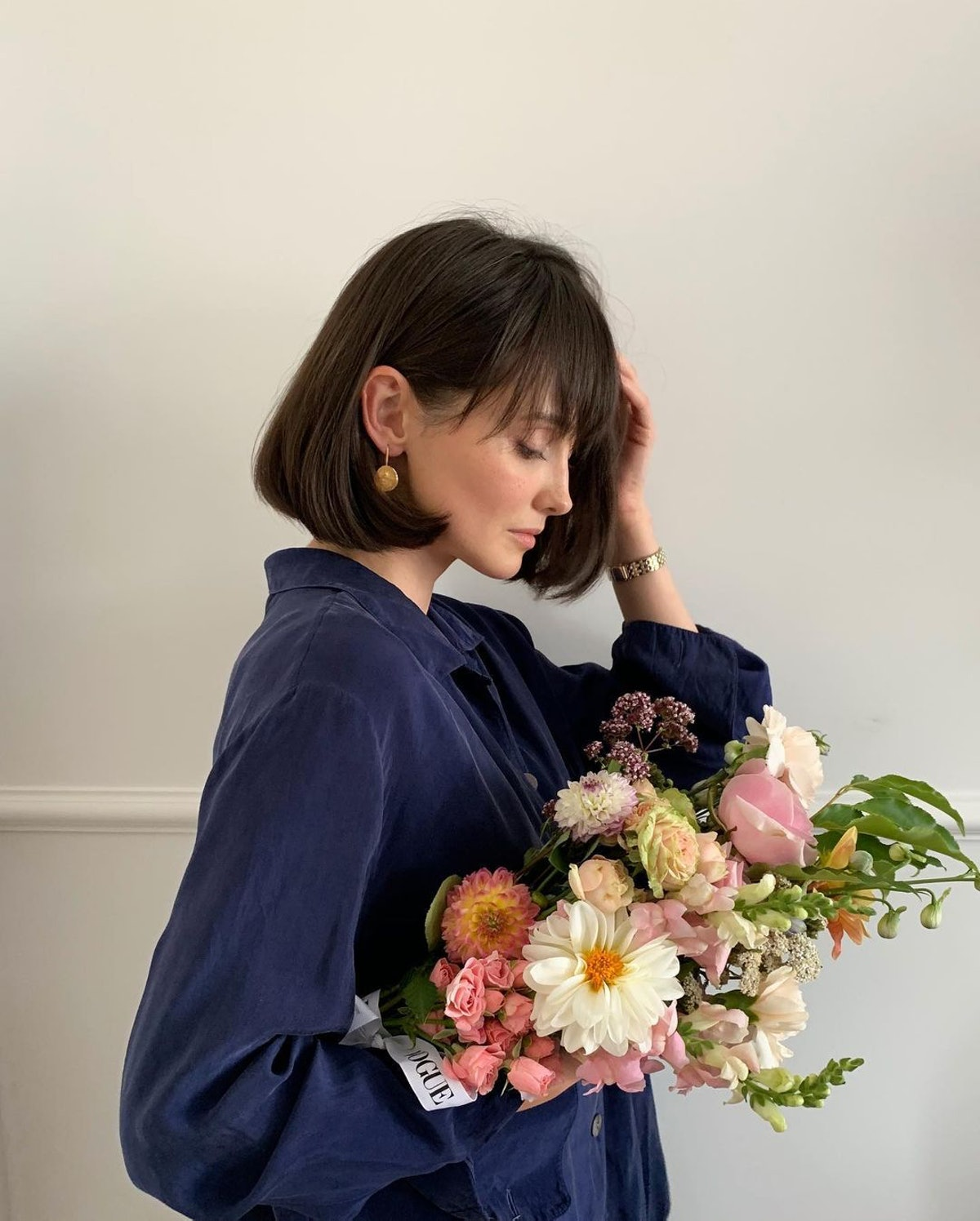 Woman holding flowers with short hair