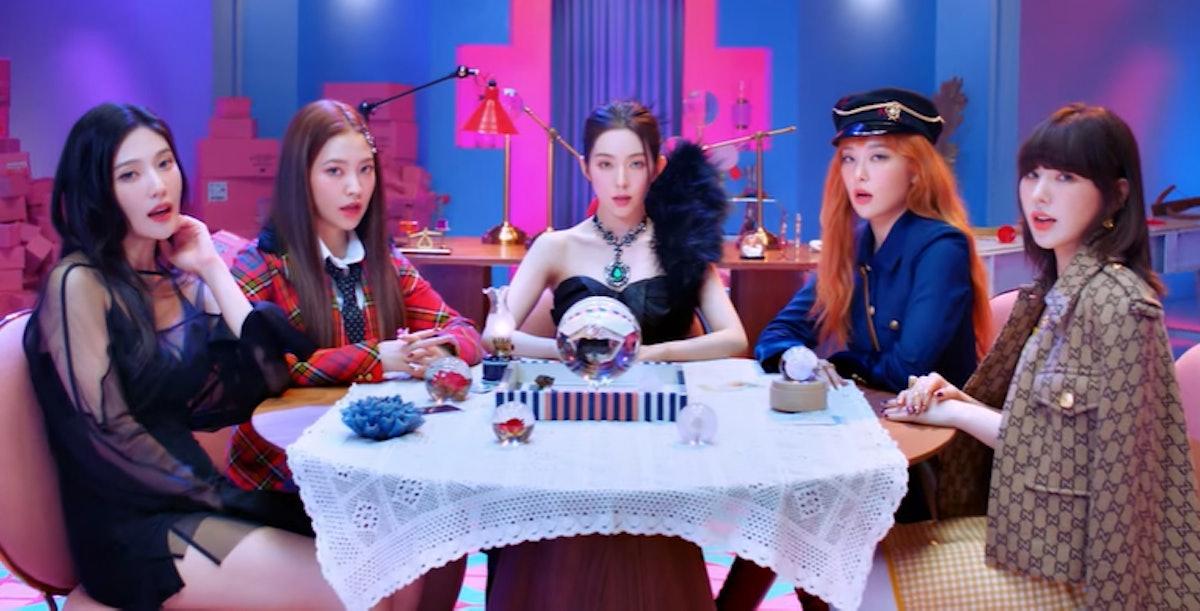 "A screenshot from Red Velvet's ""Queendom"" music video."