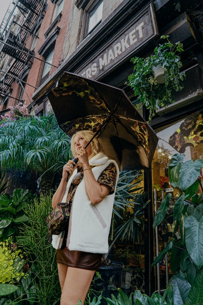 A behind-the-scenes photo of Lolo Zouaï for Coach's 2021 camo print collection campaign.