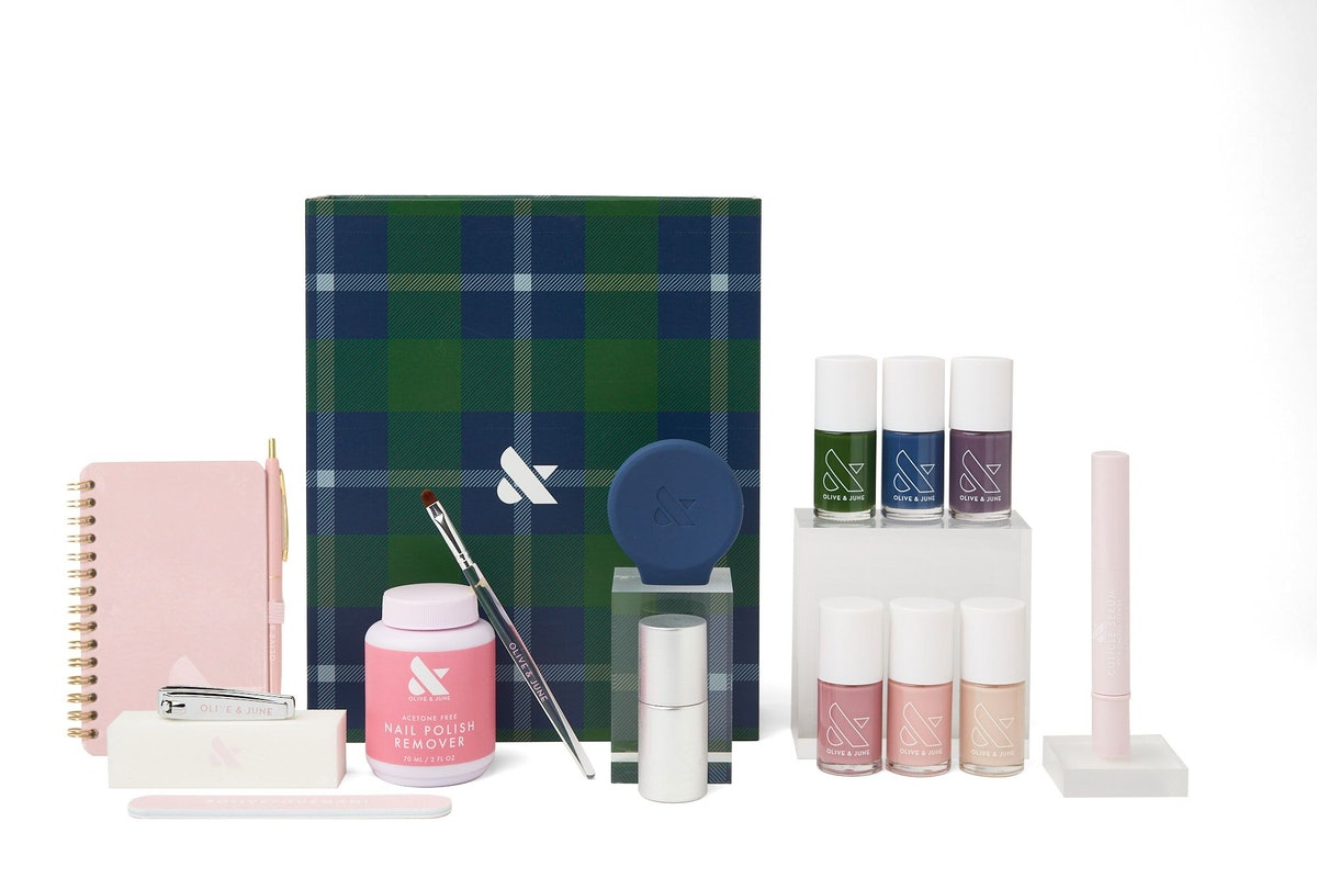 The Olive and June Fall 2021 Collection including six nail shades, manicure tools, and a plaid box.