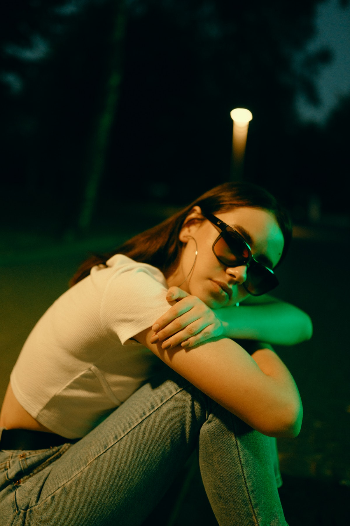 Young woman with sunglasses during Uranus retrograde 2021.