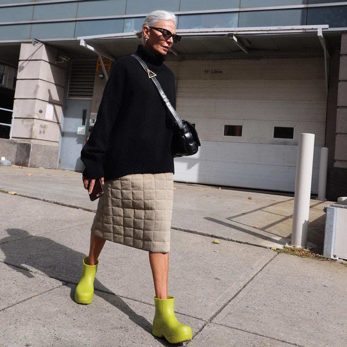 Influencer Grece Ghanem wears Bottega Veneta's Puddle rain boots.