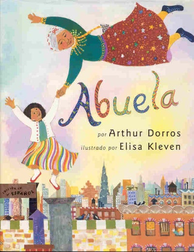 cover of Spanish children's book Abuela, featuring a drawing of a grandmother and granddaughter flyi...