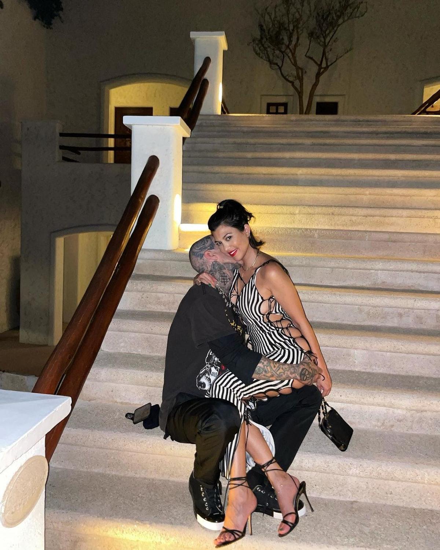 Kourtney Kardashian and Travis Barker take a photo together.