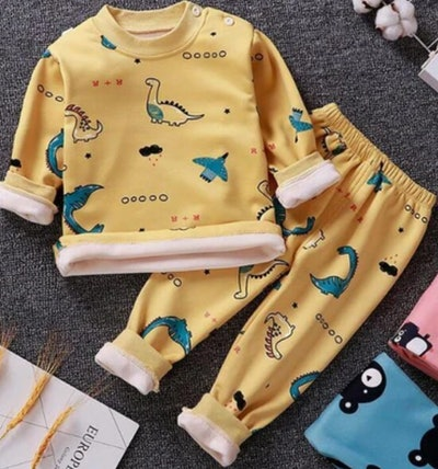 Image of young kid's yellow two-piece flannel-cotton pajama set from Tiny Jumps.
