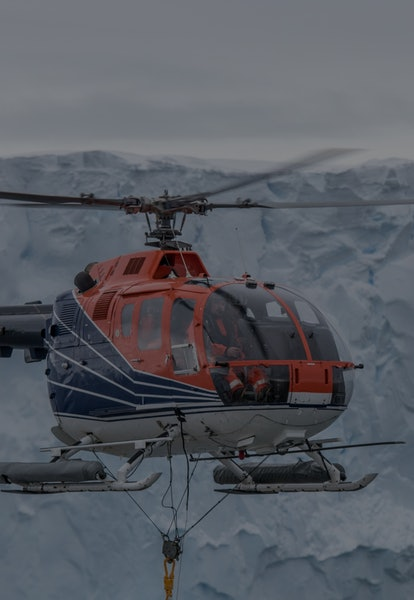 Geophysical measurements with a magnetometer being towed with RV Polarstern's board helicopter.