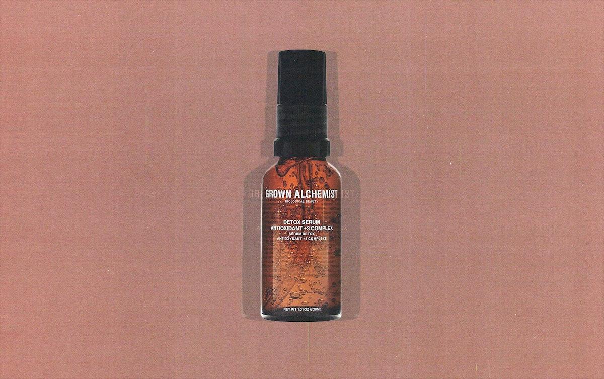 a translucent brown glass bottle of Grown Alchemist Detox serum