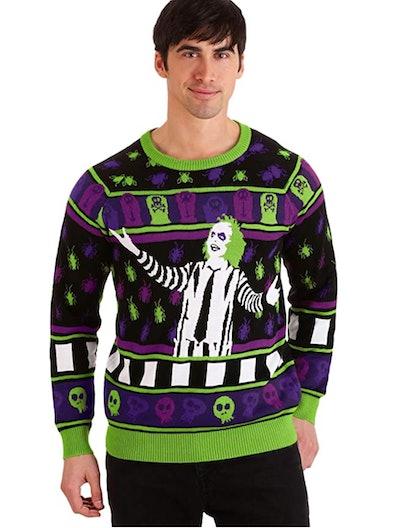 Man posing, wearing sweater featuring Beetlejuice