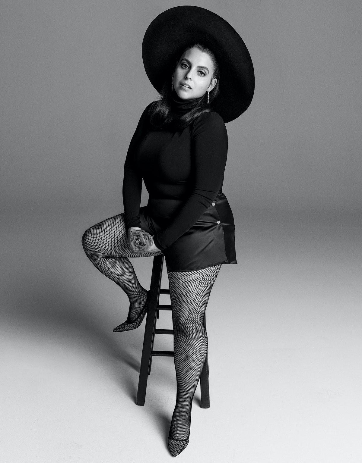 Beanie Feldstein in Banana Republic turtleneck; What Katie Did tap pants; Tiffany & Co. earrings; Wo...