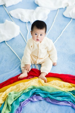 Baby on a rainbow and cloud blanket