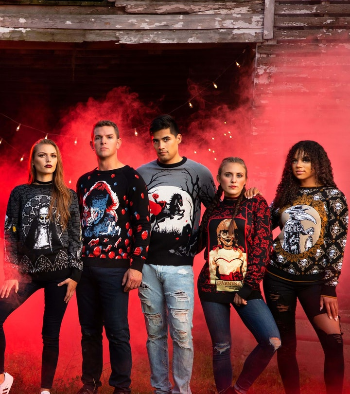 Five adults lined up, all wearing ugly sweaters for Halloween