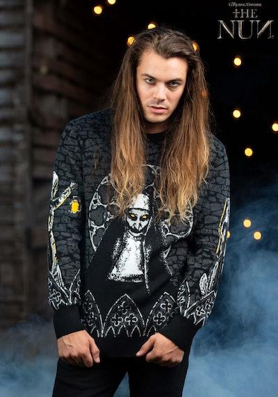 "Man posing wearing sweater featuring ""The Nun"""