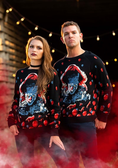 """Woman and man wearing sweaters featuring Pennywise from """"IT"""""""