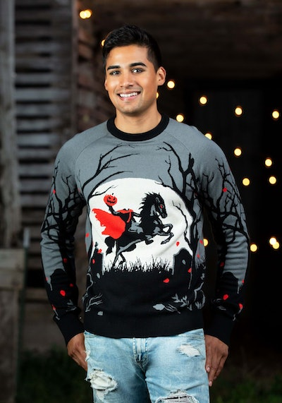Man standing in sweater featuring headless horseman in front of full moon