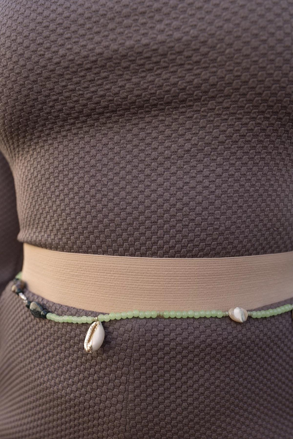 GUERASFATIM's beaded Theobabinbin belt.