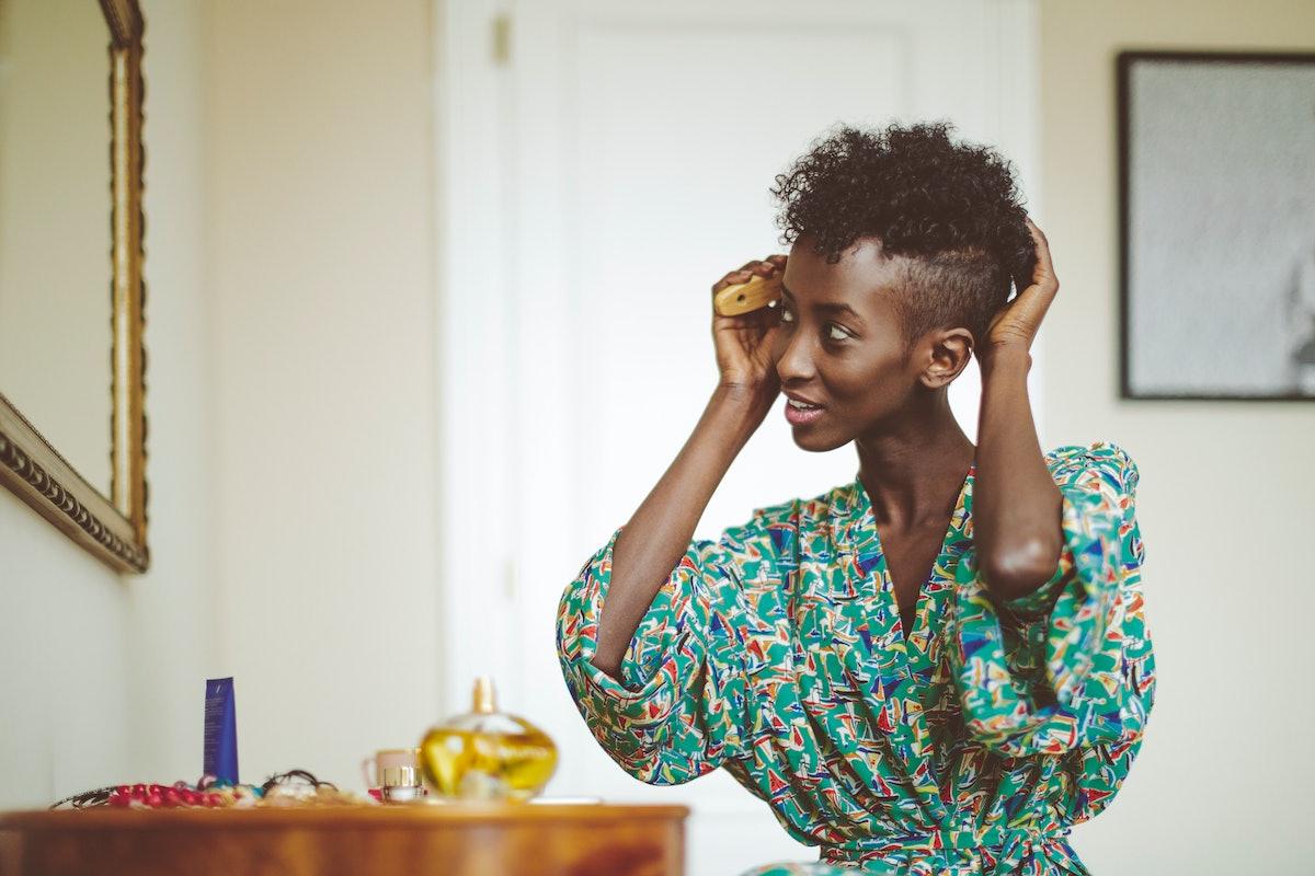 Woman brushing her hair in robe