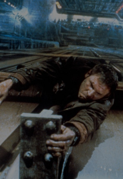 Deckard hanging from roof ledge in Blade Runner