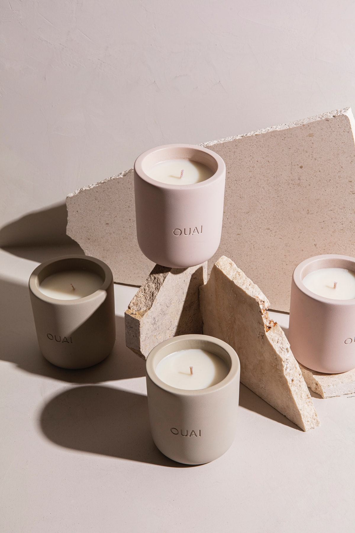 Ouai candles in Melrose Place and North Bondi arranged around rocks