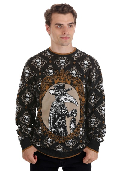 Man posing in sweater featuring Plague Doctor