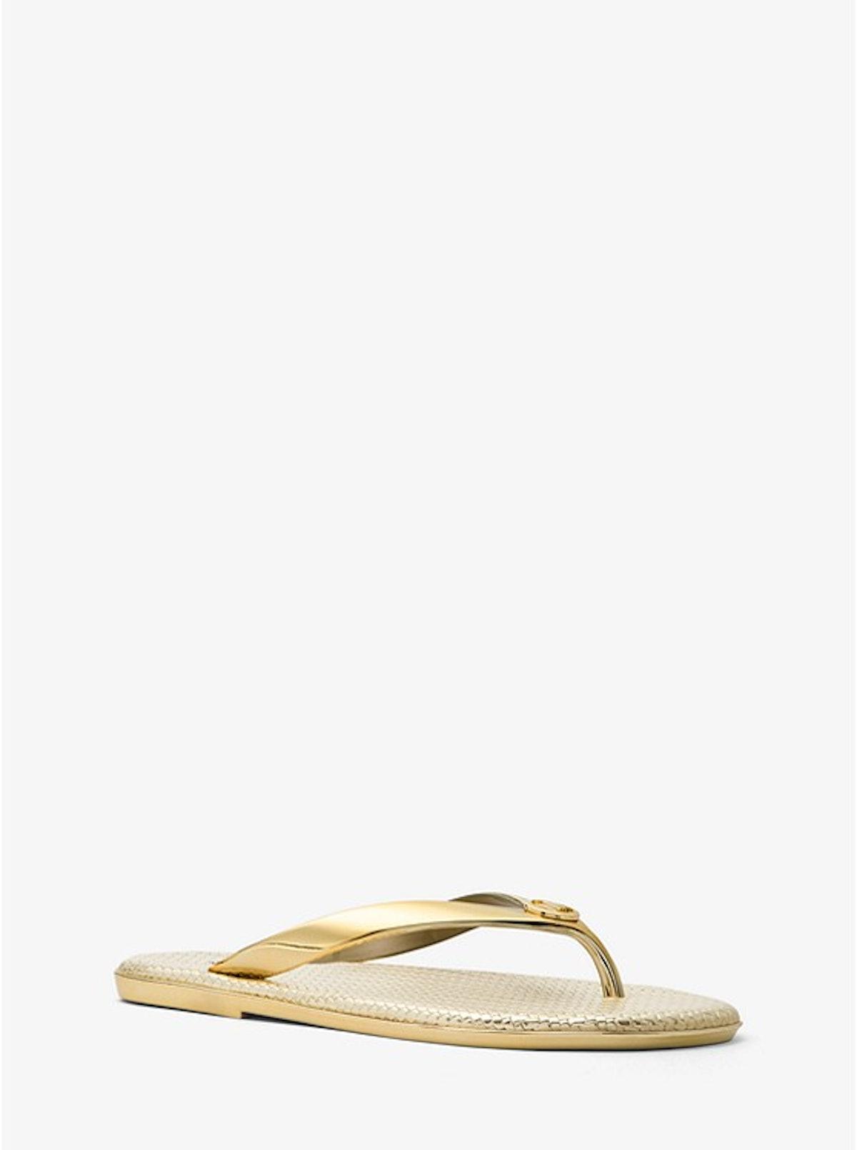 Michael Kors gold flip-flops