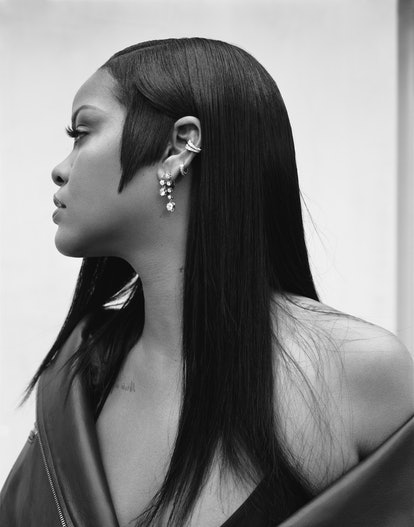 A black and white promotional image of Rihanna with blunt cut sideburns for Fenty Beauty's new fragr...