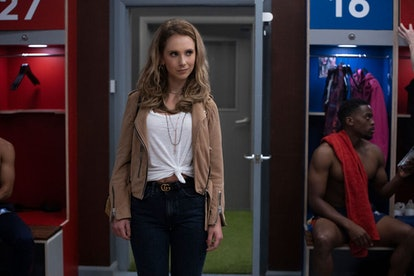 Keeley Jones (Juno Temple) whose zodiac sign is Taurus, standing in the locker room in Ted Lasso, a ...