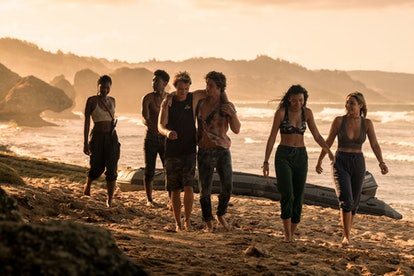 Carlacia Grant with the 'Outer Banks' cast on a beach in Season 2