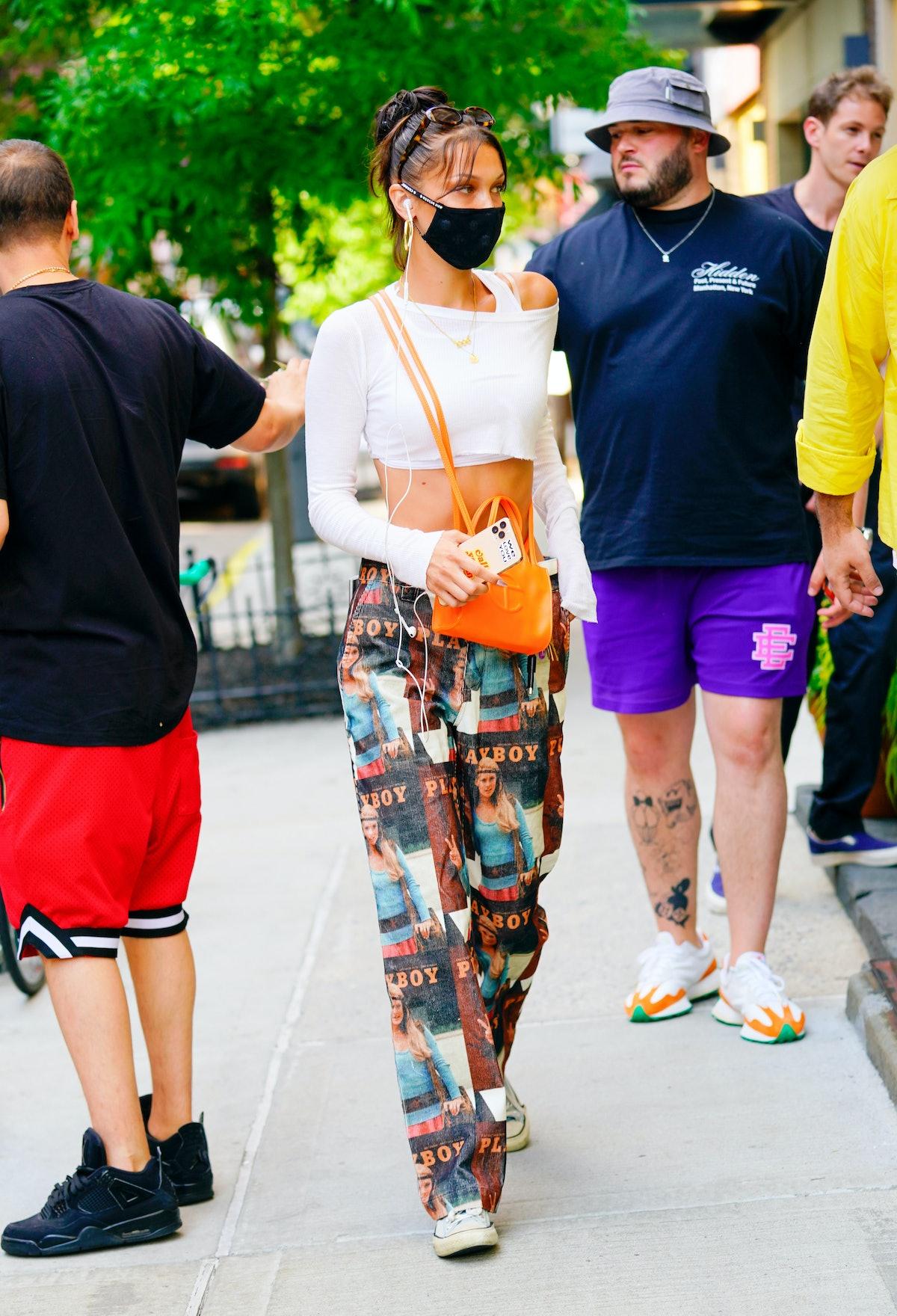 Bella Hadid with an orange Telfar bag.