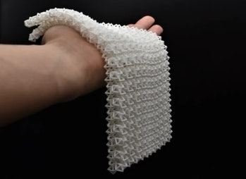 """Resembling a weighted crocheted blanket when """"fluid,"""" this material is capable of lifting 50x its ow..."""
