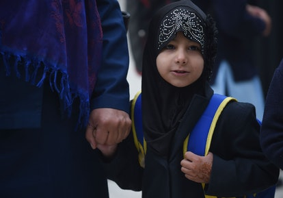 This picture taken on March 24, 2018 shows Afghan mother, Maliha, holding hands with her daughter Sa...