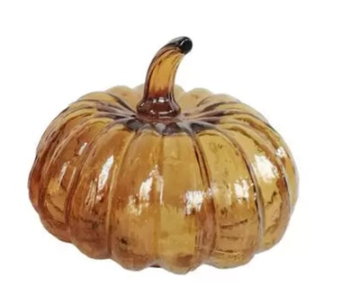 Image of small decorative glass pumpkin with interior lights.