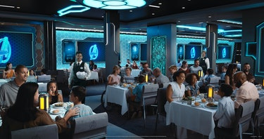 families eating in glowy, futuristic room