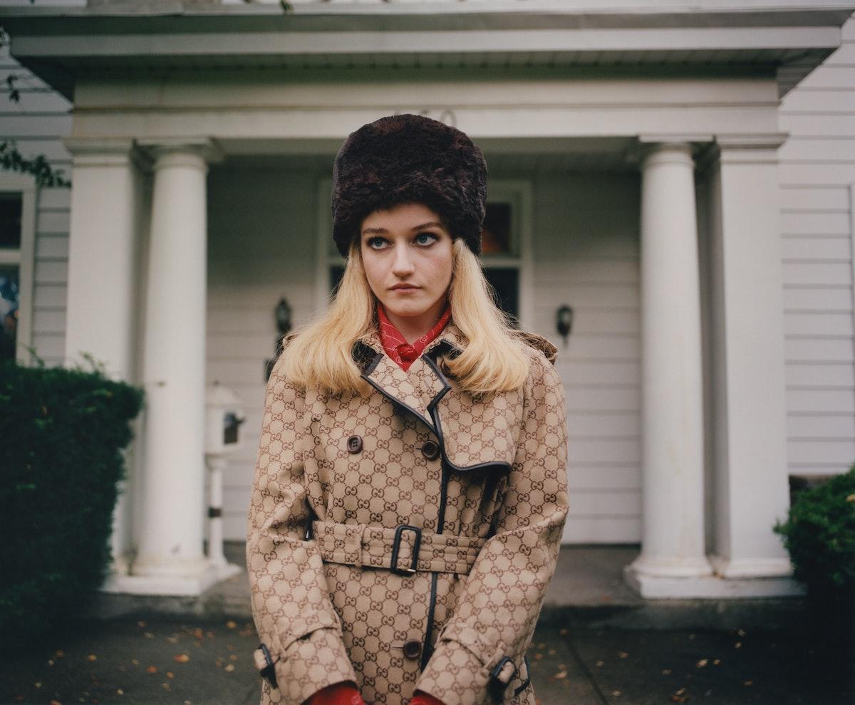 Julia Garner wears a Gucci coat and top; Emma Brewin hat.