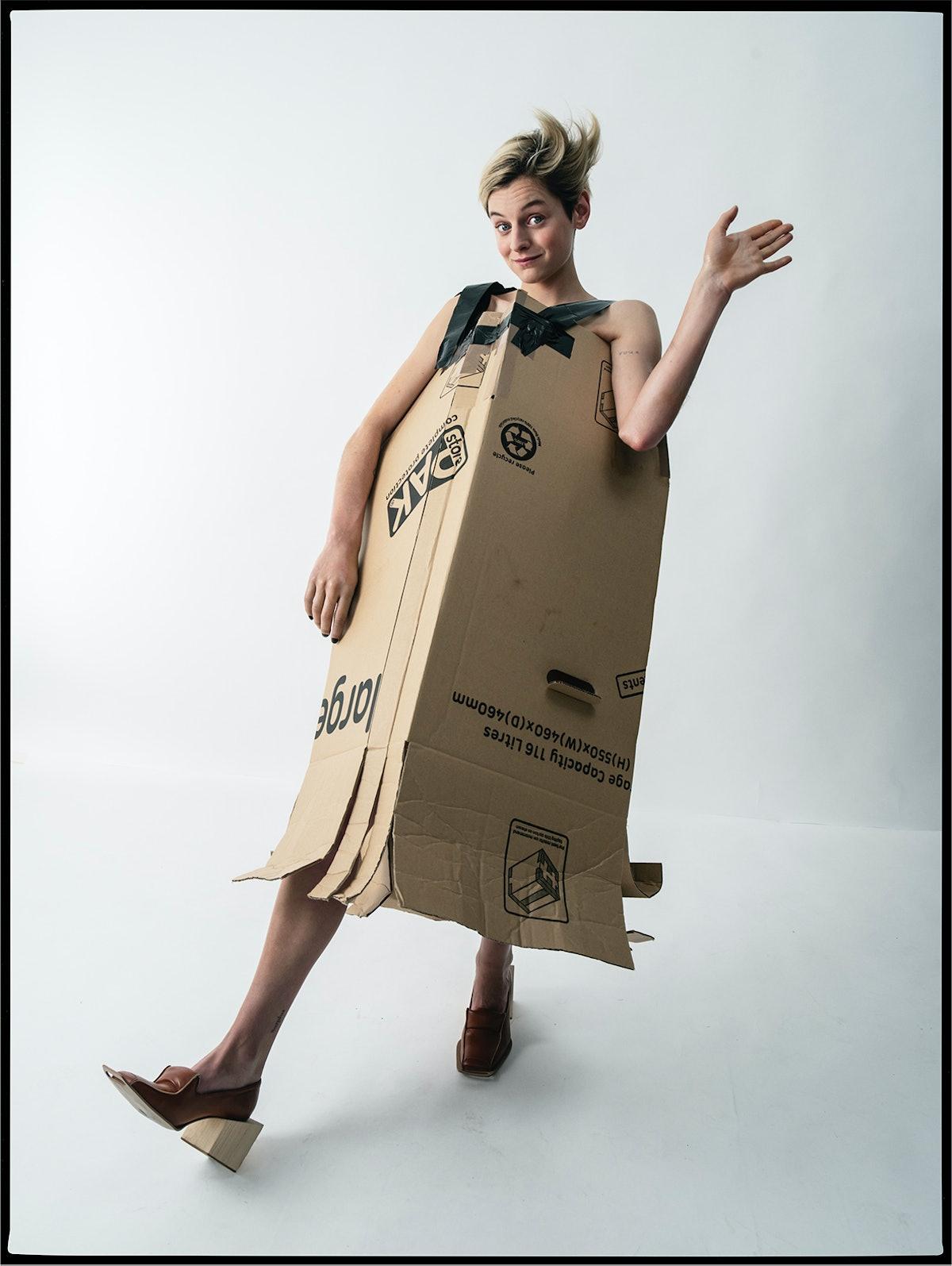 Emma Corrin wears a Laura Barnes box dress and shoes.