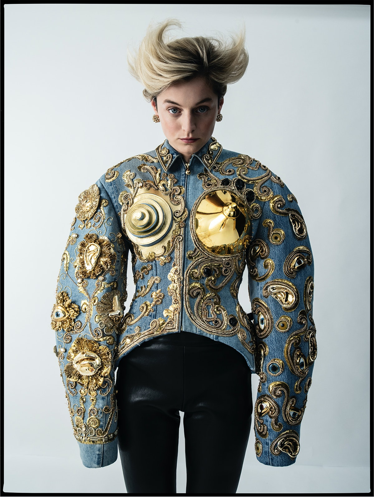 Emma Corrin wears a Schiaparelli Haute Couture jacket and pants; Cartier earrings.