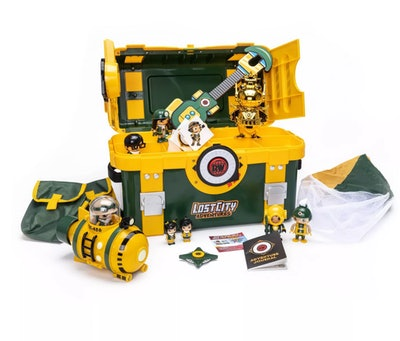 Product photo; green and yellow treasure chest with exploration accessories