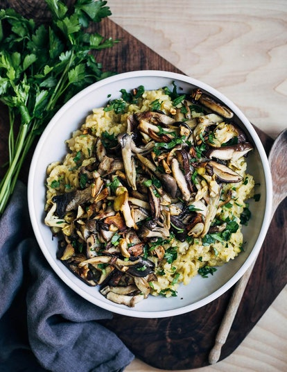 instant pot risotto topped with crispy mushrooms, served in a white bowl