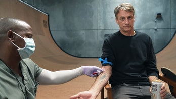 Tony Hawk giving blood for his blood-infused Liquid Death skateboard