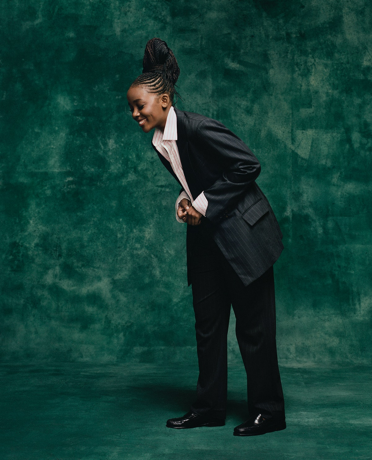 Thuso Mbedu wears a Brunello Cucinelli jacket and pants; Charvet shirt; G.H. Bass & Co. shoes.