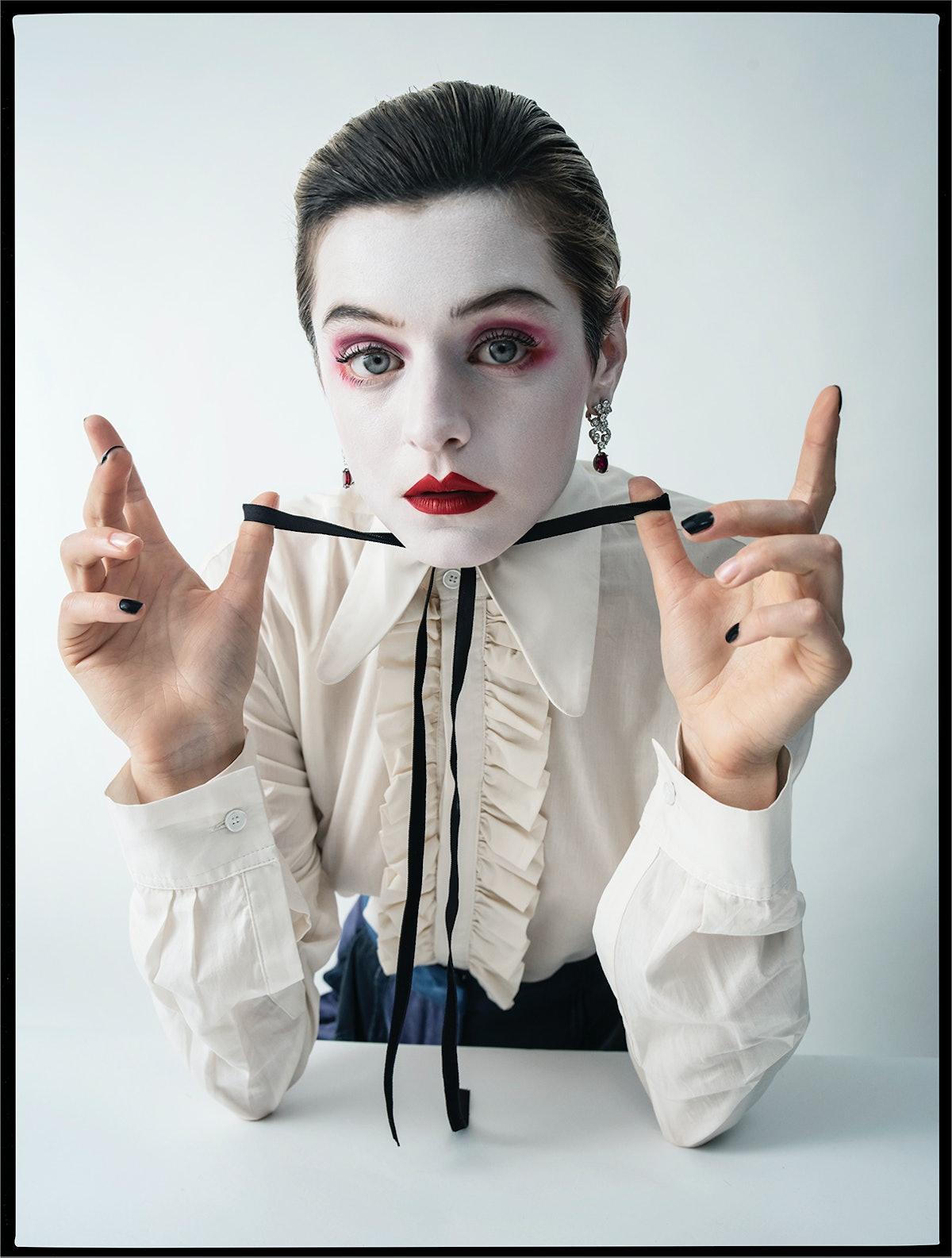 Emma Corrin wears a Molly Goddard shirt; Giorgio Armani pants; Cartier earrings; stylist's own neckt...