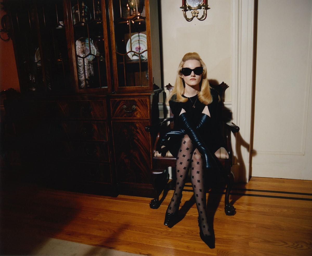 Julia Garner wears a Fendi dress and tights; Oliver Peoples sunglasses; Van Cleef & Arpels earrings;...