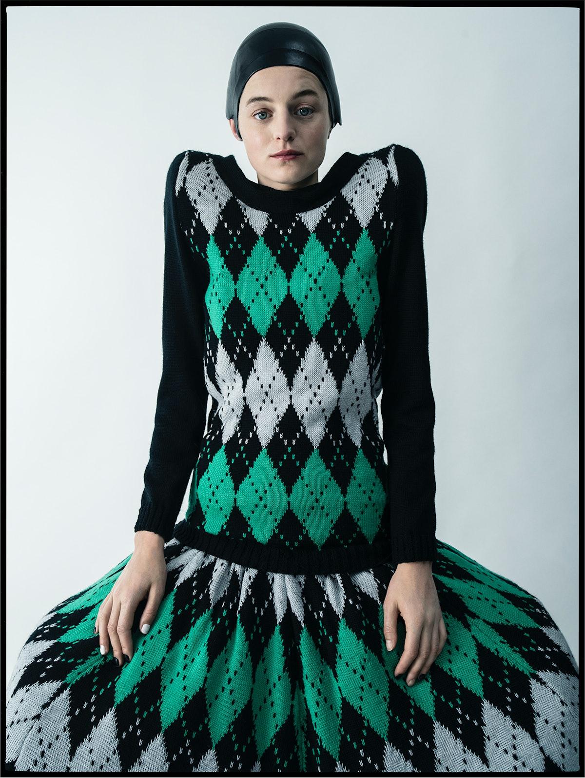 Emma Corrin wears a Laura Andraschko dress; Jo Miller Studio hat.