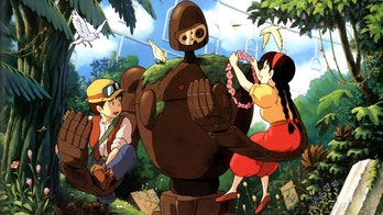 Sheeta and Pazu in the arms of one of cinema's greatest robots in Castle in the Sky