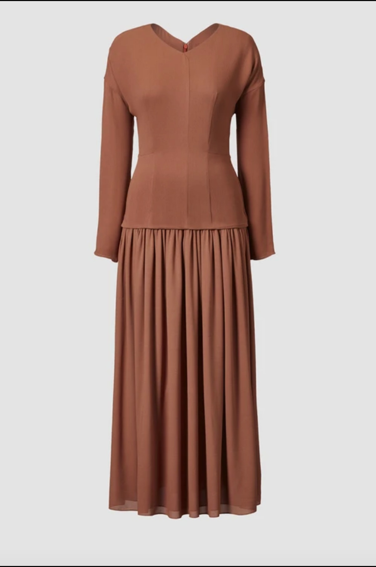 TOVE's midi dress with long sleeves in the color rust.