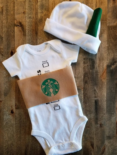 Flat-lay of a baby onesie and hat designed to look like a Starbucks coffee cup