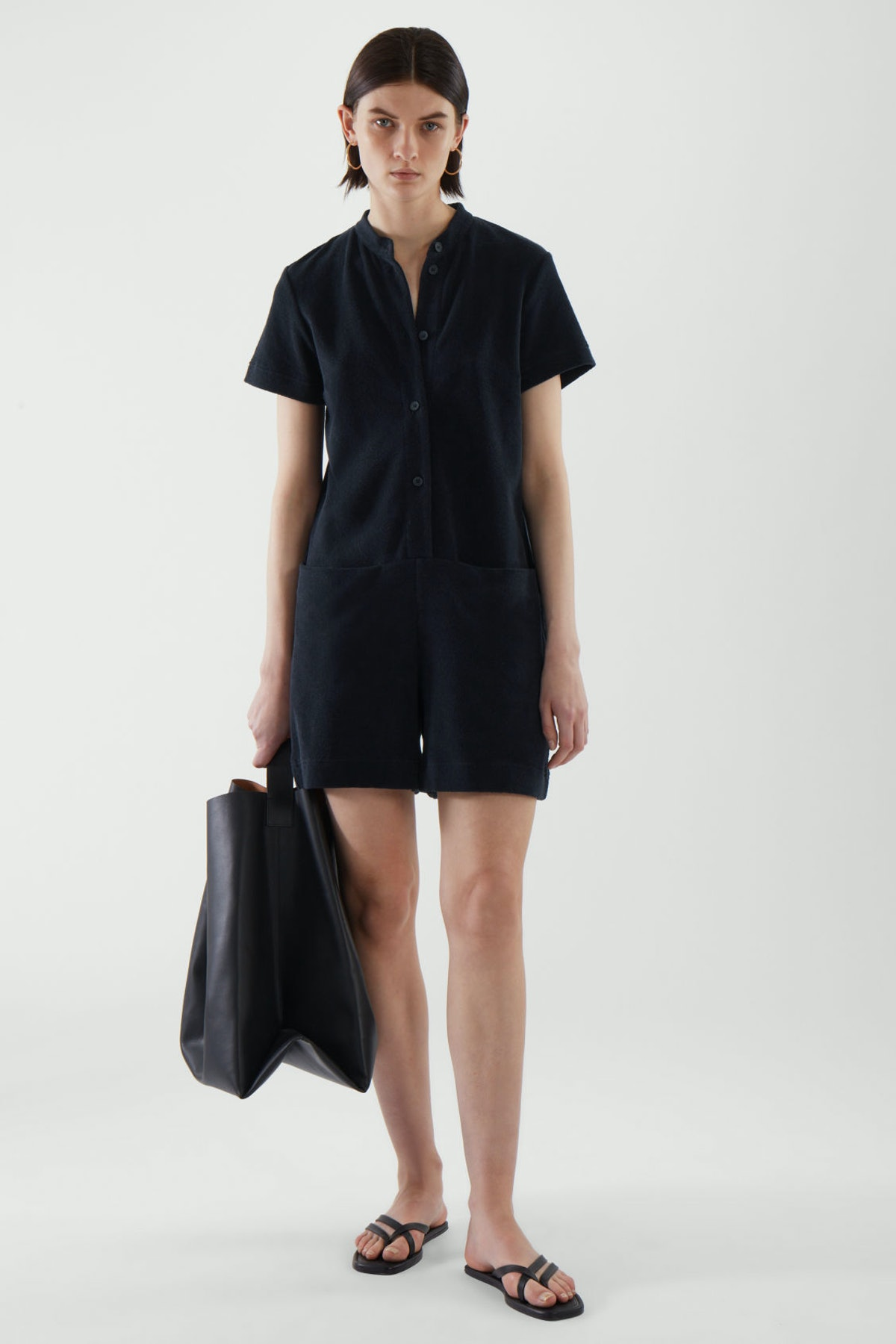 Dark navy terry towelling playsuit from COS.