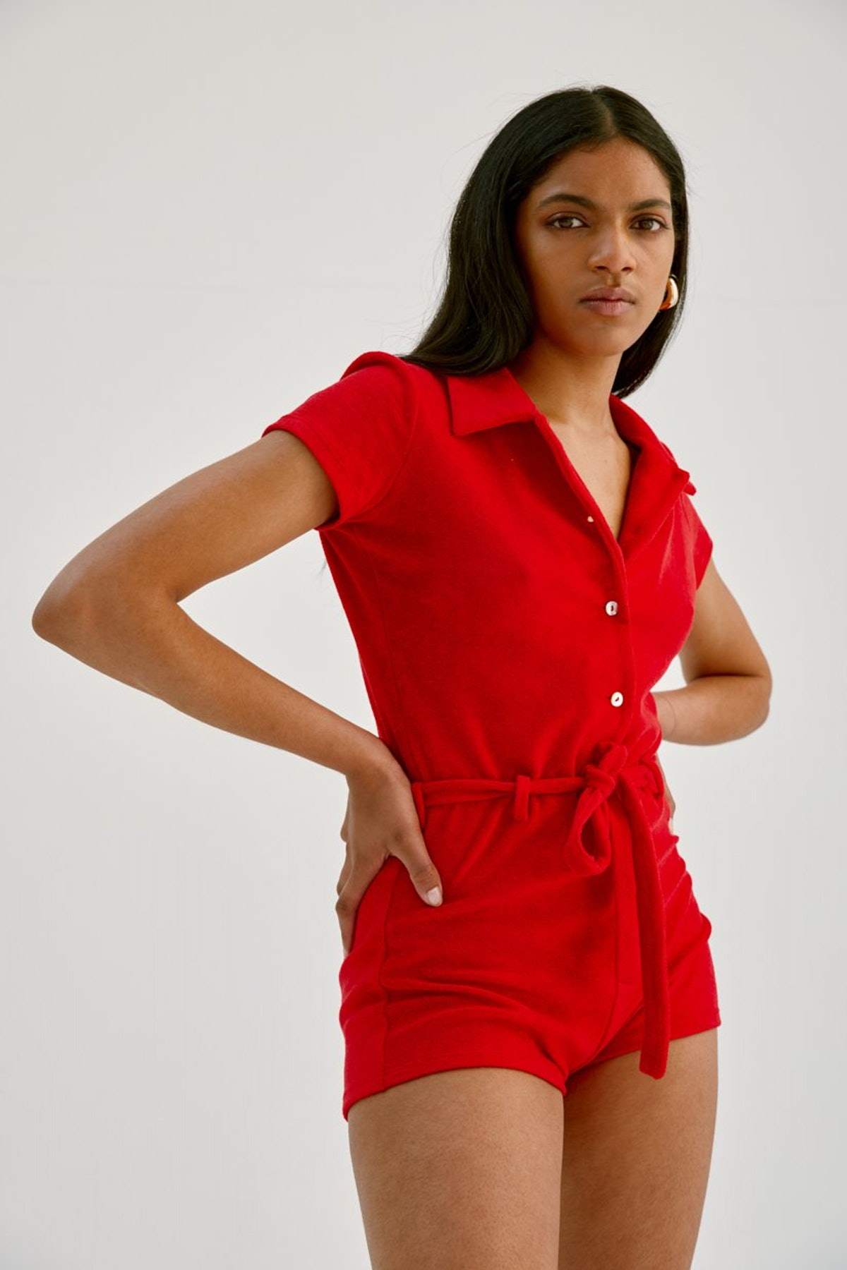 Red Abrazo Jumpsuit in Velour Terry from Musier Paris.
