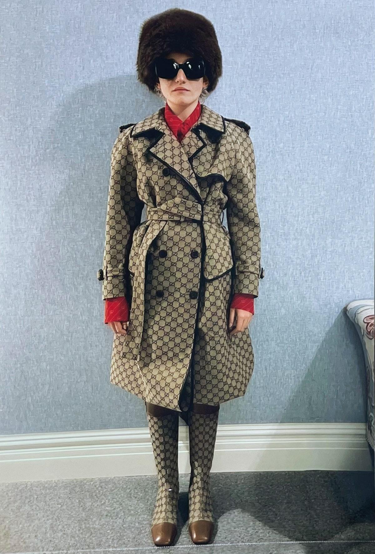 Julia Garner channeling Catherine Deneuve in a trenchcoat.